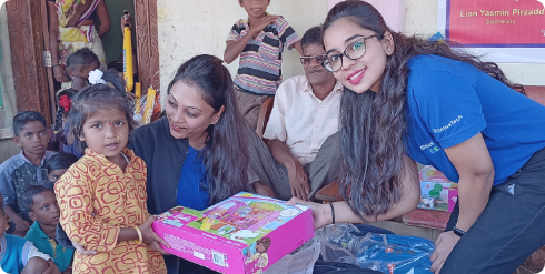 Child getting a gift from two woman