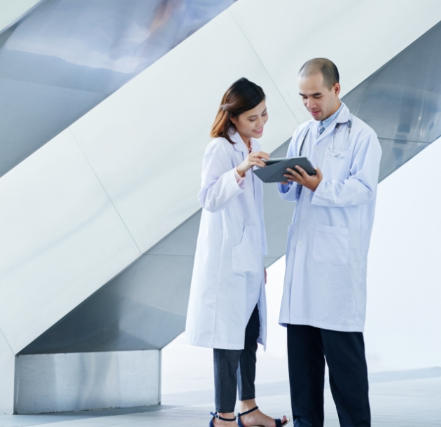 image of two doctors speaking to each other