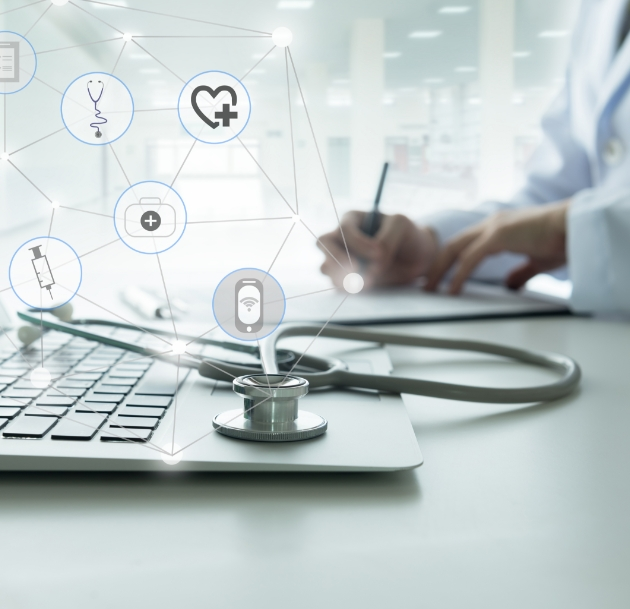 artistic image showing stethoscope resting on laptop with health icons superimposed