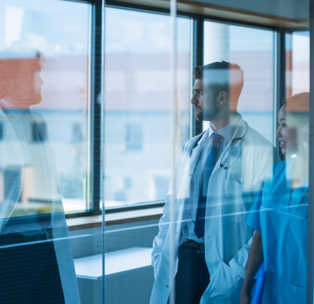 artistic image of transparent doctors standing in front of window