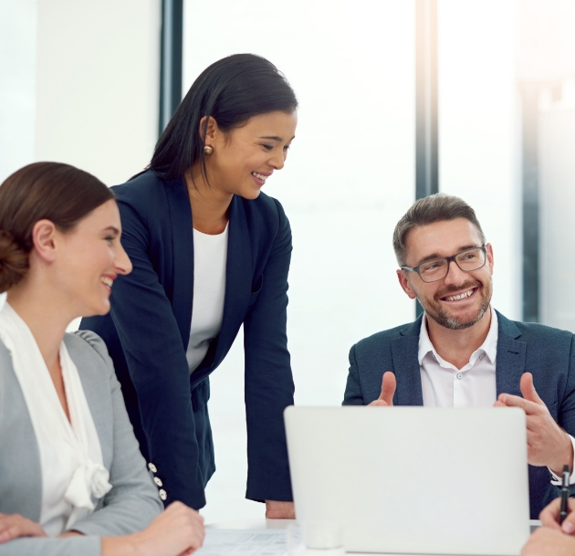 people smiling in a meeting