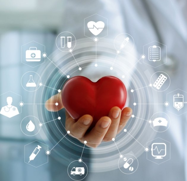 artistic image of hand holding red heart surrounded by health icons