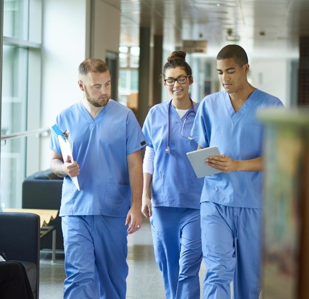 image of doctors walking down hallway