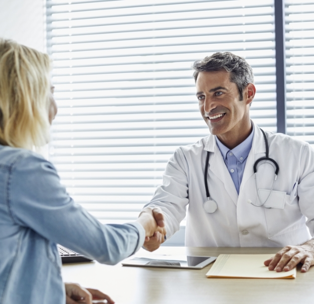 image of person and doctor shaking