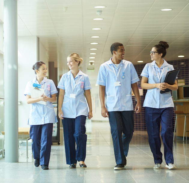 image of medical workers walking in a hall
