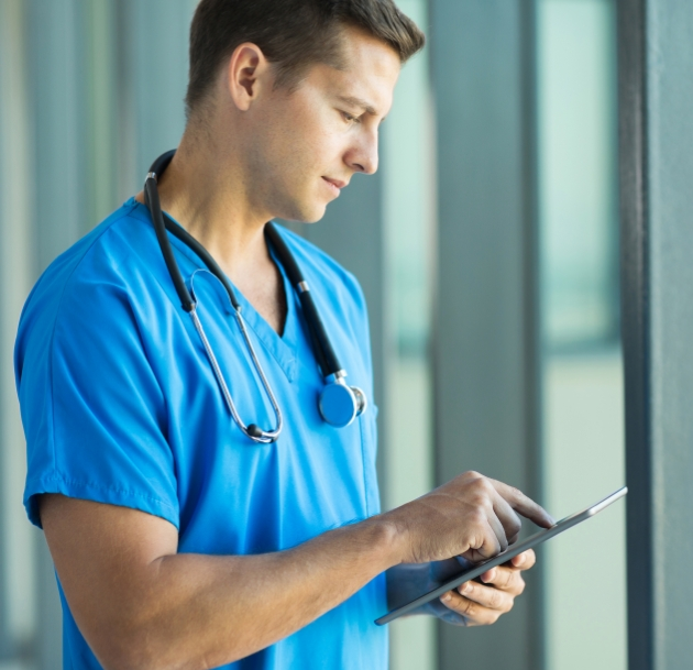doctor scrolling on tablet