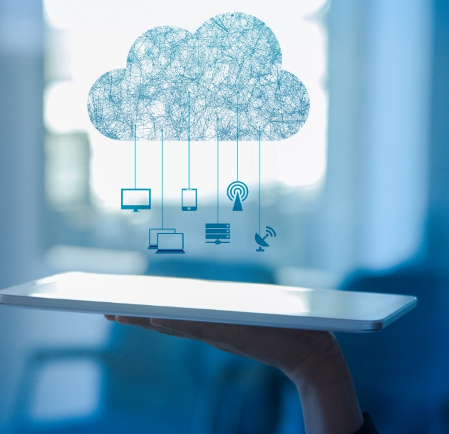 artistic image of a cloud mobile with computer monitors hanging from it over a tablet