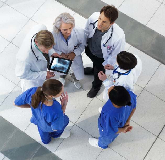 image of group of medical workers talking
