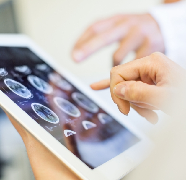 image of hand using tablet